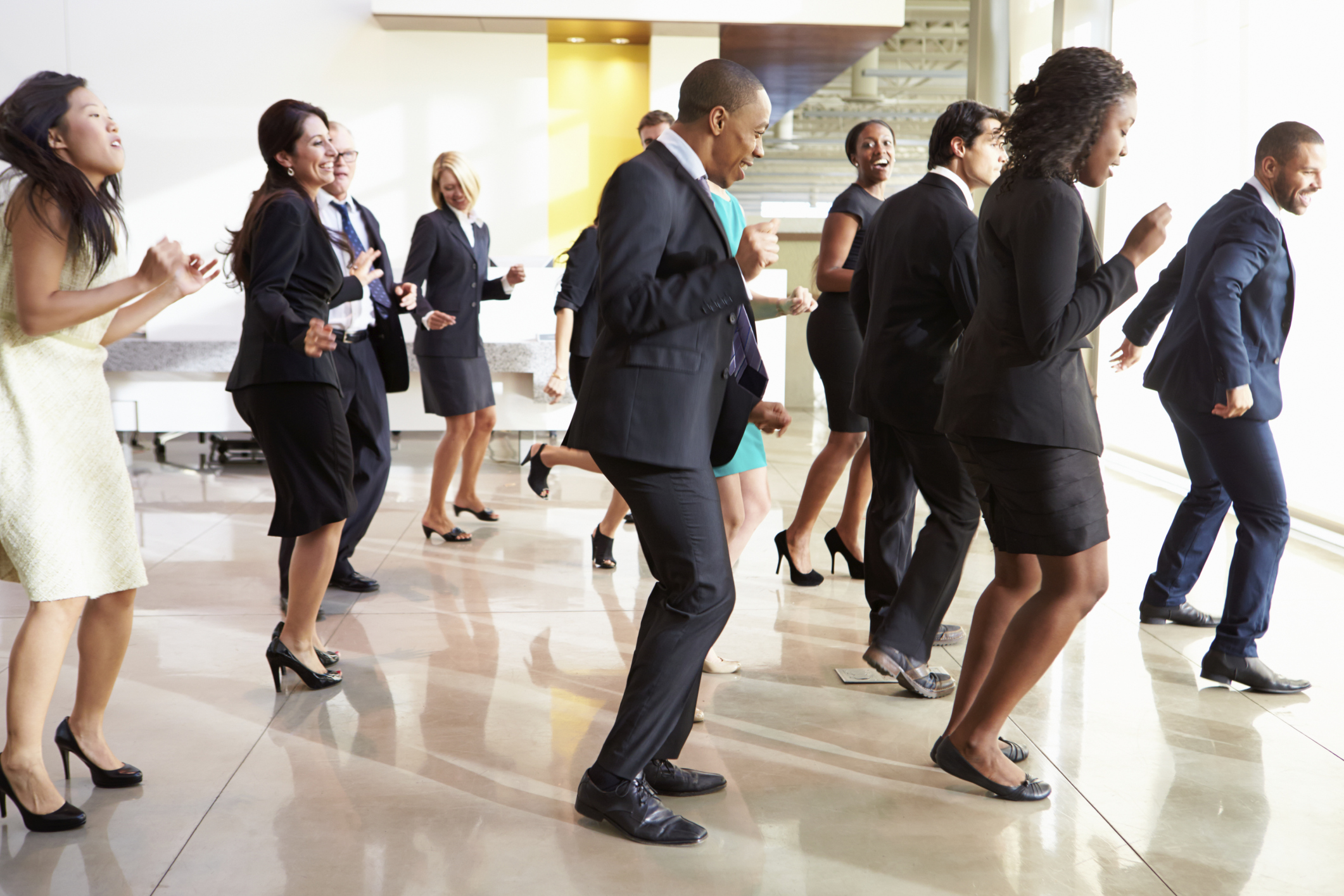 Businesspeople dancing in lobby