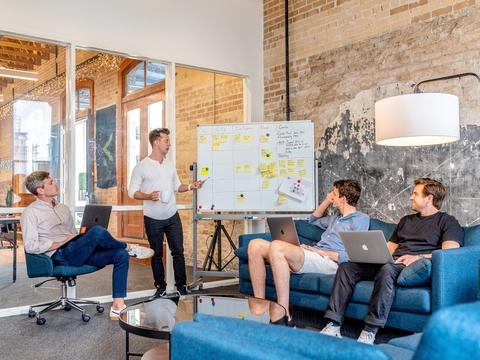 Teaching Employees on Whiteboard