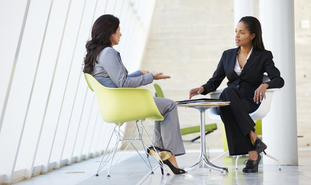 Two Businesswomen Meeting Around Table