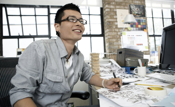 Young illustrator smiling