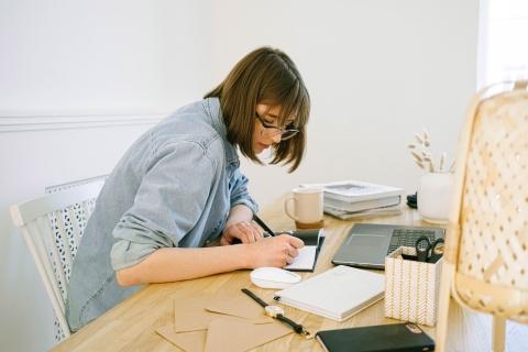 Asian women writing diary
