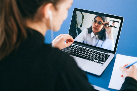 Business woman having a video call with cowork