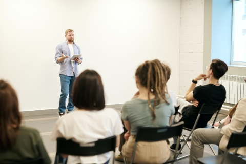 Person presenting at the front of a room